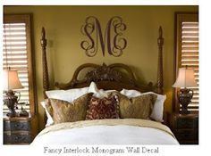 monogram above bed on wall