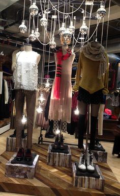 Urban Outfitters Christmas Display. Love the simplicity of it but the hanging lights brighten up the display.