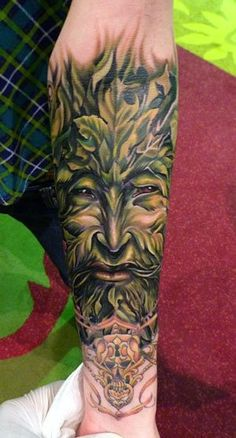 Awesome tattoo of what looks like the Celtic God of the forest and agriculture, Sucellus