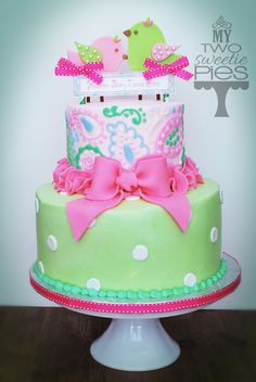 Pink and green birdie baby shower cake
