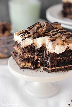 "<p>This Chocolate Peanut Butter Cup Lasagna is loaded with Reese's Peanut Butter Cups and packed with layers of chocolate. <a title=""Get Recipe Here"" href=""http://beyondfrosting.com/2015/03/02/chocolate-peanut-butter-cup-lasagna/"" target=""_blank"">Get Recipe Here</a></p>"