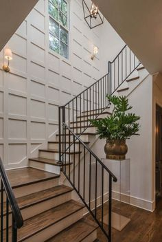 Love the board & batten grid on the stairwell wall! Love the board & batten grid on the stairwell wall! Style At Home, Stairwell Wall, Staircase Wall Decor, Entryway Stairs, Staircase Molding, Open Stairs, Wood Staircase, Stairs To Basement, Stair Wall Lights