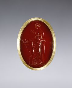 Ring inset with intaglio representing Artemis; Unknown; Egypt; 220 - 100 B.C.; Gold and carnelian; 4.1 × 2 × 0.5 cm (1 5/8 × 13/16 × 3/16 in.); 92.AM.8.8; J. Paul Getty Museum, Los Angeles, California