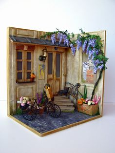 She shows how she built the corner vignette and how the wisteria and other pieces were made and put together