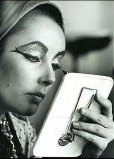 Elizabeth Taylor enhances her best known features - and why not.