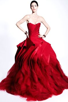 Dramatic Zac Posen formal gown in Russian Red,  made of pure glamour. This red dress has attitude. Follow RUSHWORLD! We're on the hunt for everything you'll love! Enjoy RUSHWORLD boards, UNPREDICTABLE WOMEN HAUTE COUTURE, WEDDING GOWN HOUND and STALKING YOUR ART DOPPELGANGER. Follow RUSHWORLD and pin your heart out!