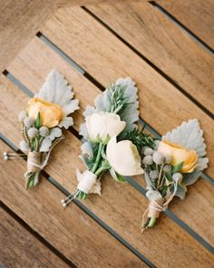 Soft pink ranunculus and dusty miller boutonnieres