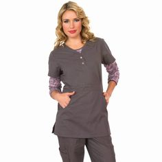 Koi Justine Top in Steel, For the woman that loves a longer length top the koi Justine is the perfect choice as it offers a longer length that comes to your upper thigh. There are two deep practical pockets and two lovely snap buttons to the front with pretty koi detail. The koi Justine top is super soft and has a synched back making it very flattering on all body shapes. £27.50  #nursescrubs #dentistuniform #nurses #dentists #greyscrubs
