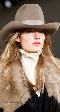 ~ From Ralph Lauren's Fall/Winter 2015 Collection.  Love the hat, high collared lace blouse worn underneath a fab pinstriped suit with a faux fur collar. ~