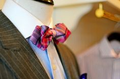 fashion forward: pinstripe suit + very bright colorful tie