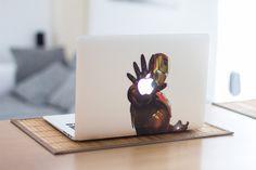 IronMan decals on a MacBook.