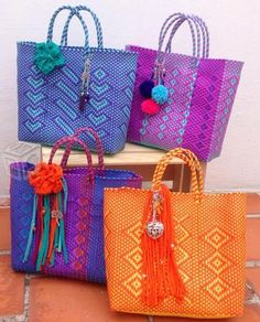Love these bags which are sold in San Miguel Allende, Mexico and to a lesser extent in towns like Merida, Mexico. Sorry, the links go no where.I could have a ton of these minus most of the tassels. Diy Tote Bag, Canvas Purse, Mexican Designs, Market Bag, Purses And Handbags, Fashion Bags, Straw Bag, Chanel, Shopping Bag