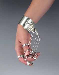 A collection of jewelry designed by artist Jennifer Crupi that forces the wearer to make a particular gesture.
