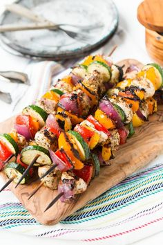 These Tuscan grilled chicken kabobs are so easy and we eat them all summer long. Bright, fresh colors and fresh flavors for dinner tonight!