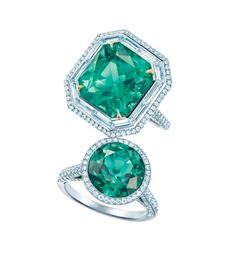 Tiffany & Co. emerald cut, unenhanced emerald and round diamond cocktail rings, set in platinum with gold prongs.