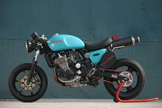 Triumph, not to fond of the color but no bad,  love the bike tho, cafe style but modern