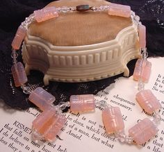 An outstandingly lovely molded pink glass necklace from Czechoslovakia. Circa 1920's, the glass is a lovely pink/purple opalescent
