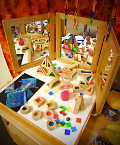 These colourful blocks and the mirror allow children to build up their spatial awareness whilst experimenting with construction and 3D shapes.
