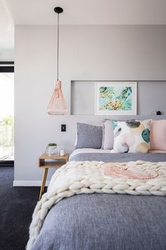 scandi bedroom with touch of pink