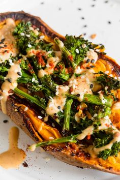 Broccoli Rabe and Hummus Topped Sweet Potatoes - a hearty vegan meal Sweet Potato And Broccoli Recipe, Broccoli Rabe Recipe, Sweet Potato Toppings, Sweet Potato Recipes Healthy, Loaded Sweet Potato, Sweet Potato Chili, Broccoli Recipes, Vegan Recipes, Vegan Stuffed Sweet Potato