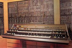 Without question the sickest and most insane modular synthesizer set-up, as well as his studio, anywhere in the world. This is his Yamaha in front and PART,yes just part of his Moog Modular. Moog Synthesizer, Analog Synth, Zimmerman, Piano, Music Instruments, Yamaha, Homes, Studio, Retro