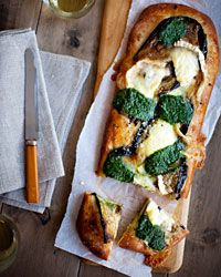 Eggplant, Pesto, and Goat-Cheese Pizza | Tangy goat cheese, sharp Parmesan, tender sautéed eggplant, and bold pesto cover a mouth-watering pizza.  #howisummer