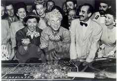 CHICO, HARPO and GROUCHO MARX at the Roulette Table from the Marx Brothers classic comedy, A NIGHT IN CASABLANCA (1946).  Lots of inlaid Comet roulette chips