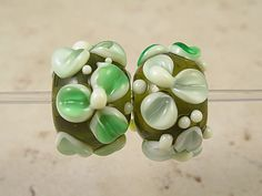 Green Lampwork Glass Bead Pair Raised Flowers has a Stamen with an Attitude. $16.00, via Etsy.