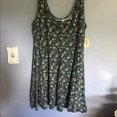 NWT Floral Skater Dress  NWT Floral Skater dress with tank top straps. Made from very stretchy material. Please feel free to ask me any questions and make some offers. I will take any reasonable offer  Aeropostale Dresses Mini