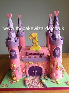 Castle cake. Love the brick work, path and door! Where to get edible flowers like these..... They really as to it!