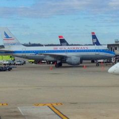 Airbus A319. USAir gives a nod to acquired Piedmont airlines with vintage livery.