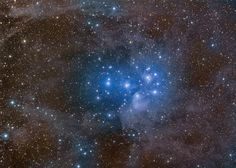 From NASA.com — The Pleiades. Perhaps the most famous star cluster in the sky, the Pleiades can be seen without binoculars from even the depths of a light-polluted city. Also known as the Seven Sisters and M45, the Pleiades is one of the brightest and closest open clusters. Hurtling through a cosmic dust cloud a mere 400 light-years away, this star cluster is well-known for its striking blue reflection nebulae.
