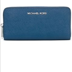 Michael Kors wallet  New . With the tag attached blue color with silver zipper MICHAEL Michael Kors Bags Wallets