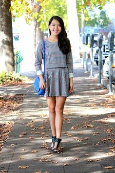 Shop this look on Lookastic:  https://lookastic.com/women/looks/white-and-black-crew-neck-sweater-white-and-black-skater-skirt-black-heeled-sandals-blue-crossbody-bag/5327  — Blue Leather Crossbody Bag  — White and Black Plaid Crew-neck Sweater  — White and Black Plaid Skater Skirt  — Black Leather Heeled Sandals