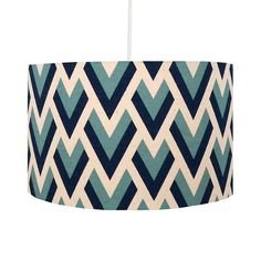 This stylish handmade drum lampshade in a blue geometric print is perfect for any contemporary or retro style room.This handmade lampshade features a geometric arrow design in shades of blue. Suitable for ceiling pendants or lamp bases with UK or Continental fittings. All lampshades are handmade by us especially for you. We use a variety of fabric prints and the pattern at the seam will not always join up.Handmade using cotton fabric applied to a pvc lampshade backing material.Approximate…