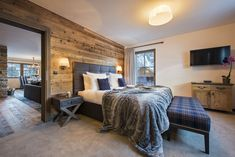 Chalet Zari, St Anton is part of the Eden Rock building and includes access to a shared wellness area, including indoor pool and a social shared bar area. Part of the Firefly Collection. Ski Chalet, Anton, Bar Areas, Rustic Design, Lodges, Skiing, Indoor, Luxury, Bed