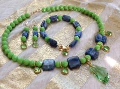 Kyanite, a beautiful gemstone mined in Sri Lanka, is highlighted in this set with Swarovski's Galactica faceted pendant crystal.  The bright green contrast beads are Czech glass with #Swarovski crystal drops.... a conversation piece at best! #necklace #jewelry