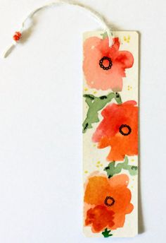 As a person who always has her nose in a book, I can really appreciate a cute hand-painted bookmark! This is Orange Blossom of my abstract flower