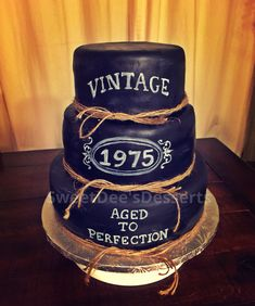 Vintage whiskey 40th aged to perfection cake. More