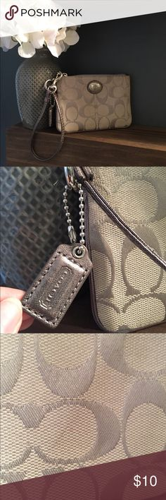 COACH Wristlet Cute COACH wristlet. Could use cleaning; some spots and minor discoloration from wear - see photos. Price reflects imperfections. Coach Bags Clutches & Wristlets
