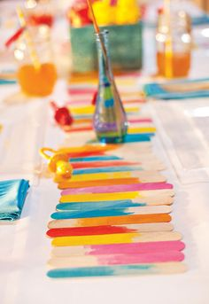 DIY: Popsicle Stick Table Runner is easy and will add a pop of color to your next party! #colorful #party #diy
