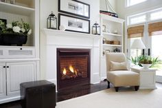 Firepalce with white mantle and bookcases