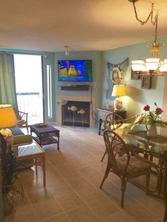 Refurbished LR including new ceramic tile flooring and UHD TV in Water Pointe 1 unit 504, North Myrtle Beach, SC.