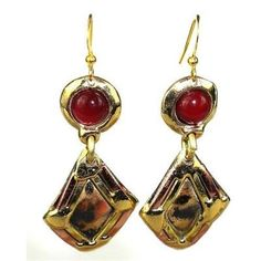 Handcrafted in South Africa, these long diamond-shaped brass earrings that hang inches are accented with carnelian stones and copper.The coloration on the brass is achieved using high heat rather than paints or dyes.Meet the Artisans . Brass Jewelry, Crystal Jewelry, Jewelry Accessories, Tribal Jewelry, Women's Jewelry, Gold Jewellery, Vintage Jewelry, Handcrafted Jewelry, Earrings Handmade