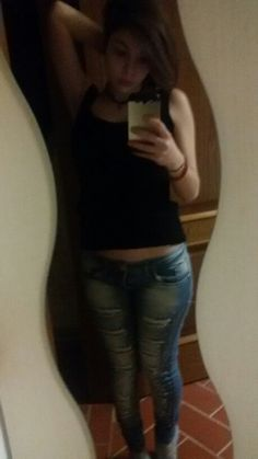 Black shirt and jeans