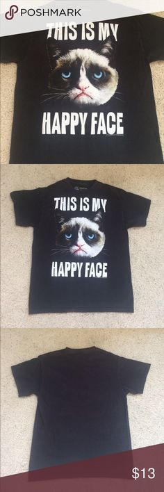 """Grumpy Cat Mens Shortsleeve Casual Graphic Tee Grumpy Cat brand graphic tee shirt in a men's size medium- I think it has shrunk a little and would probably fit a small too. 100% Cotton. Features an angry looking cat with the words """"This is my happy face"""". In mostly gently used condition, no stains or holes. There is some wash wear(minor fading). Measurements available upon request! If you have any questions please don't hesitate to ask! 🤗 Grumpy Cat Shirts Tees - Short Sleeve"""
