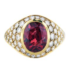 This ring is gorgeous! East African diamond and natural ruby set in yellow gold. Just a mere $19,500.