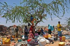 Week of Feb 28 - Mar 6, 2015 Somali refugees stand among scattered belongings after their temporary shelters in Mogadishu were destroyed by Somali soldiers after the government ordered the demolition of makeshift homes. Mohamed Abdiwahab/Agence France-Presse/Getty Images