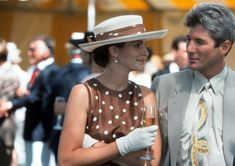 Vivian gets transformed into a high lady of society in the 90s film 'Pretty Woman'. Wearing a brown polka dot dress, matching hat and gloves; she fits the prim and proper role.