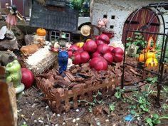 Scarecrow protecting the Fairy Garden.